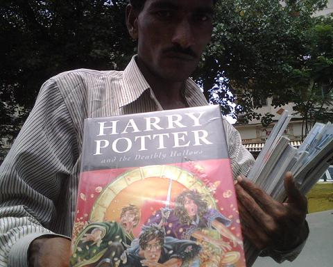 Man on the street selling Harry Potter